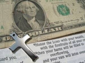 829324-word-of-god-with-cross-and-money-open-to-bible-verse--proverbs-3-9-10-honor-the-lord-with-your-wealt